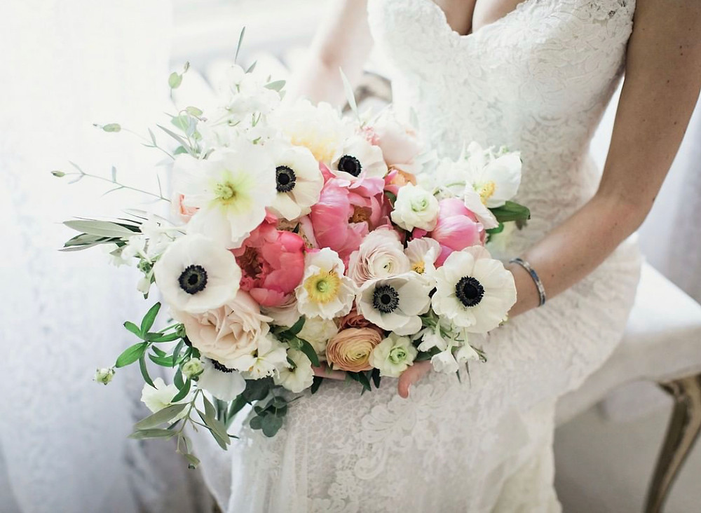 Coral peony wedding bouquet at Wainwright House