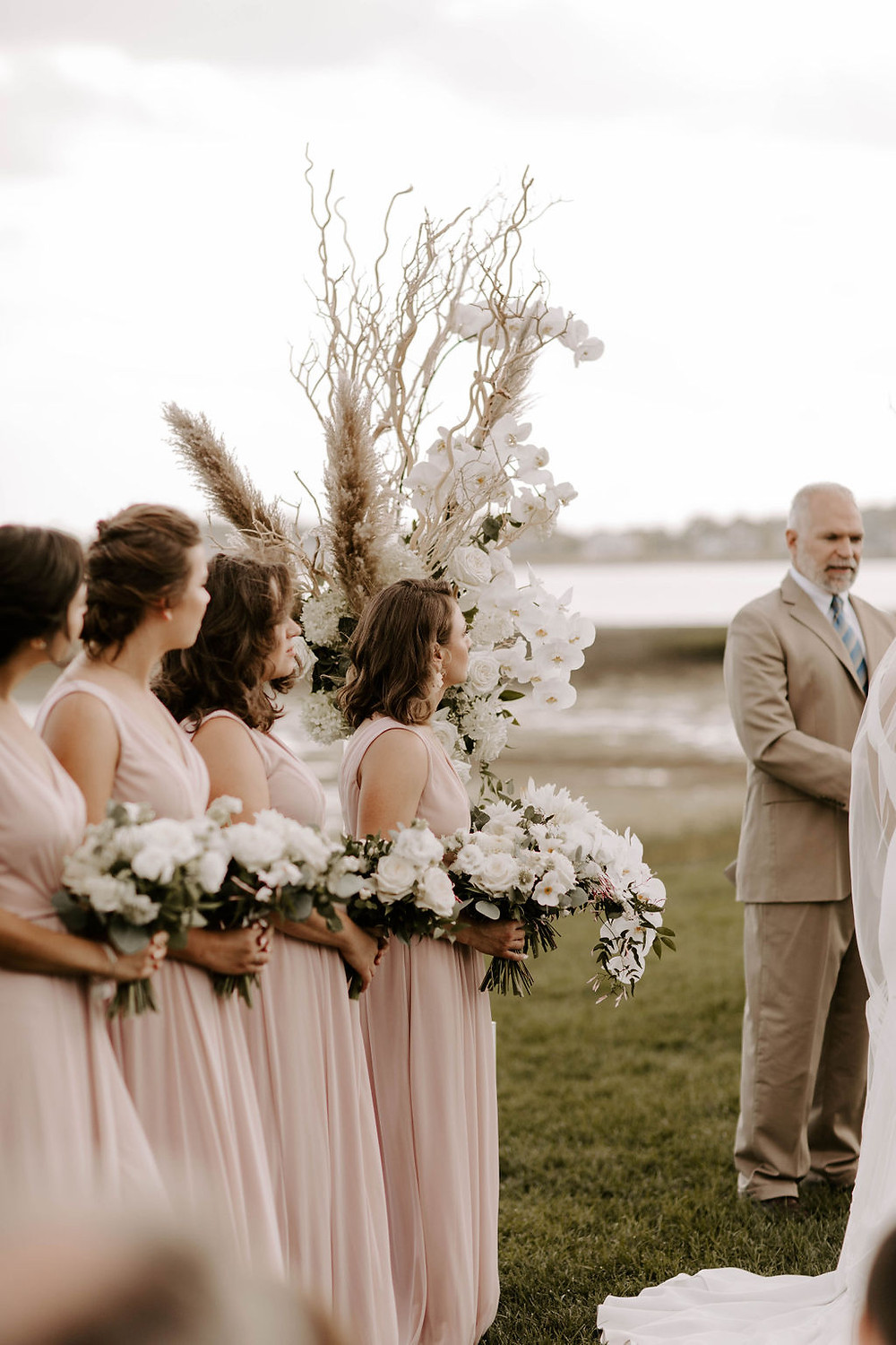 Blush bridesmaids dresses and white bouquets