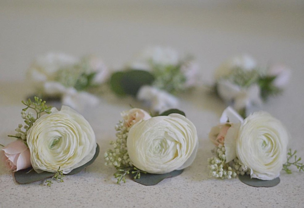 White Ranunculus boutonnieres with blush Spray roses and Eucalyptus seeds and dollar silver Eucalyptus leaves