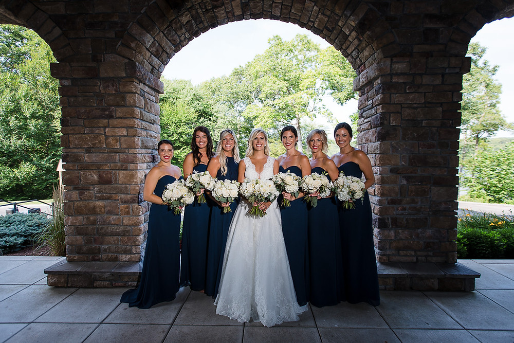 Navy blue bridesmaids with white bouquets