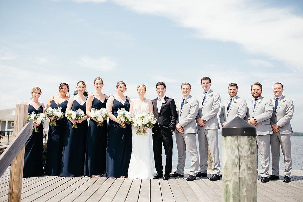 Bridal party with navy blue bridesmaid's dresses