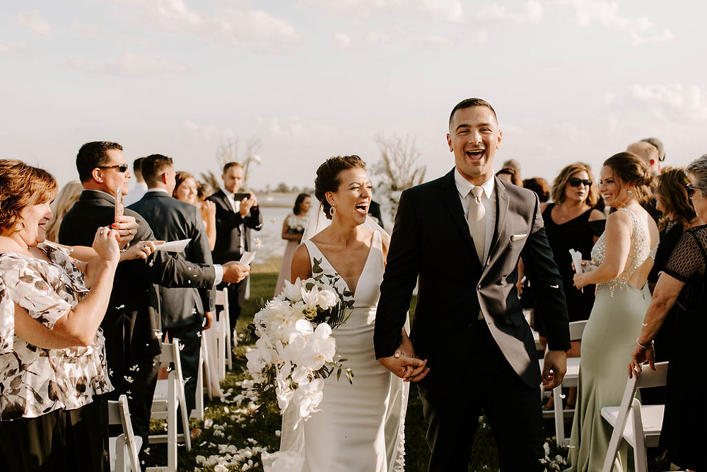 White summer wedding ceremony at The Inn at the Longshore