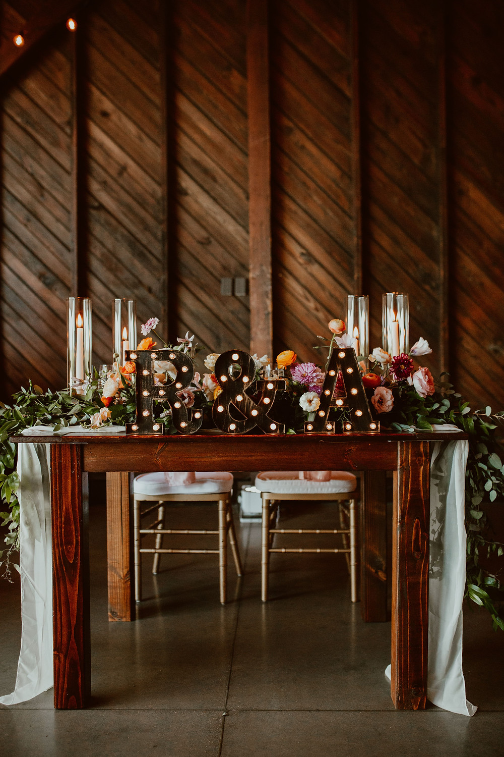 Colorful sweetheart table at Saltwater Farm Vineyard