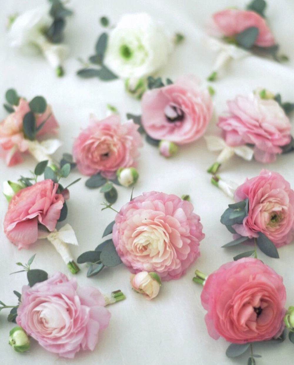Simple boutonnieres with Ranunculus and Eucalyptus