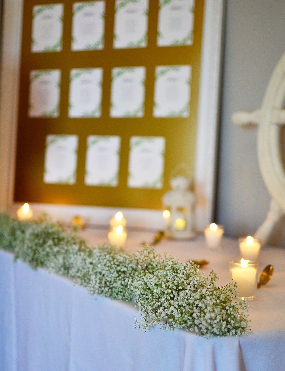 Dahlias & Baby's Breath White Wedding at Guilford Yacht Club | Baby's breath garland at welcome table