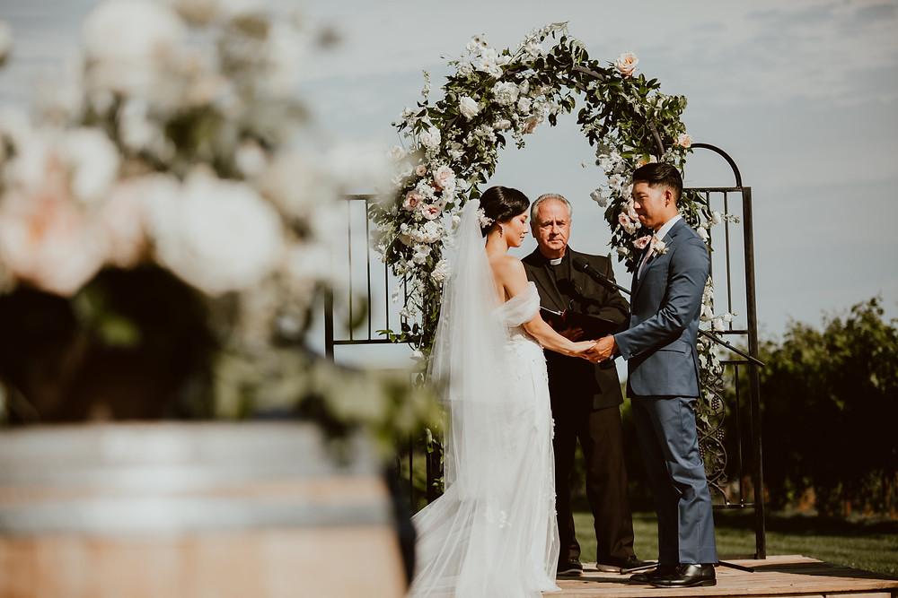 Summer wedding ceremony at Saltwater Farm Vineyard