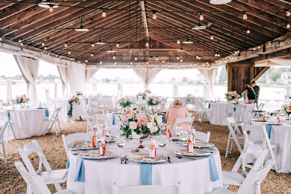 Blush & light blue Dahlia centerpieces at Boat shed in Mystic Seaport Museum