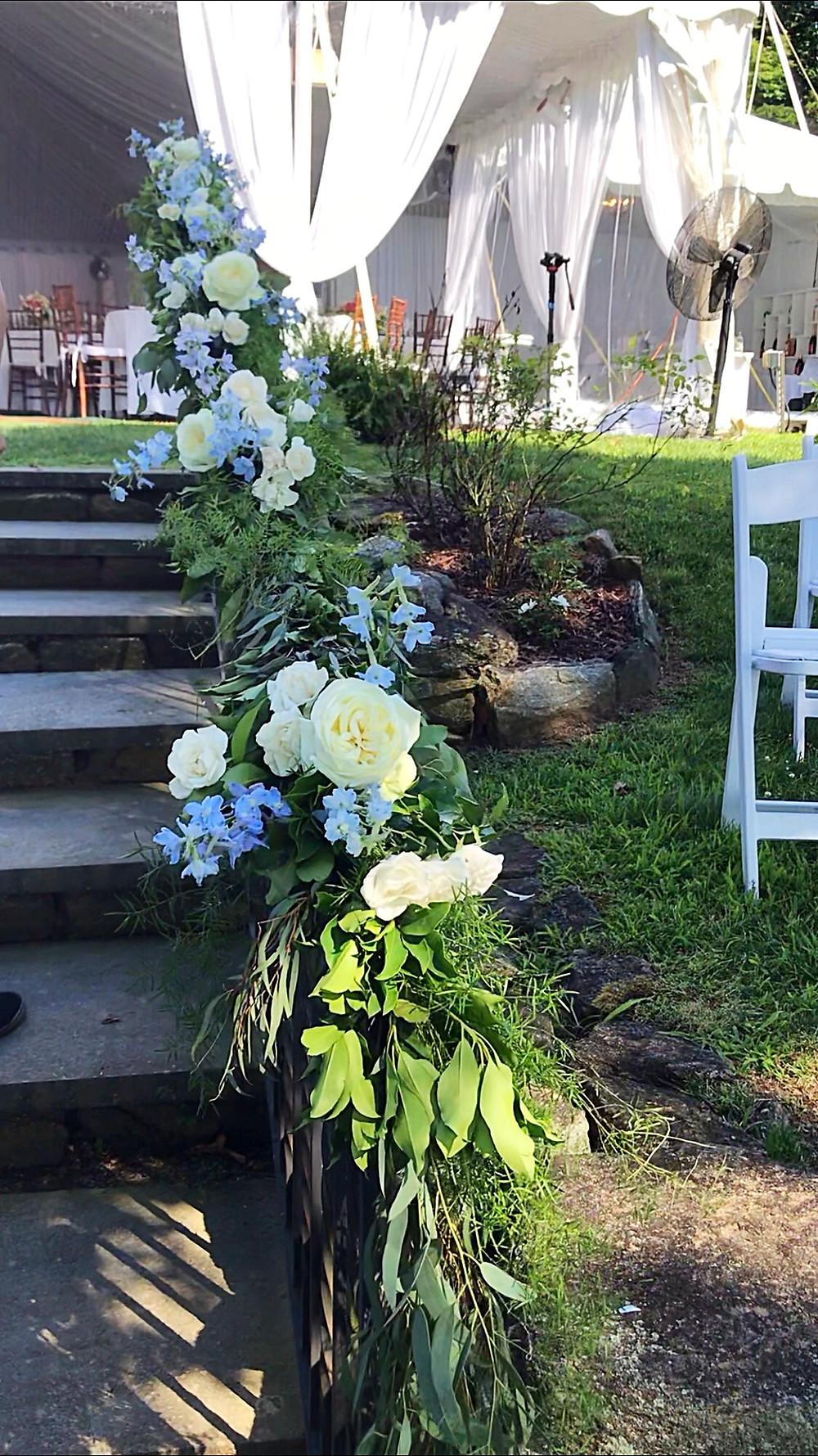 Stair rail flower decor at