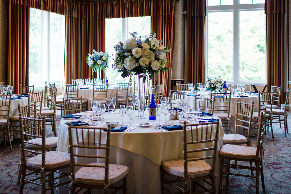 White & blue tall centerpieces at Lake of Isles