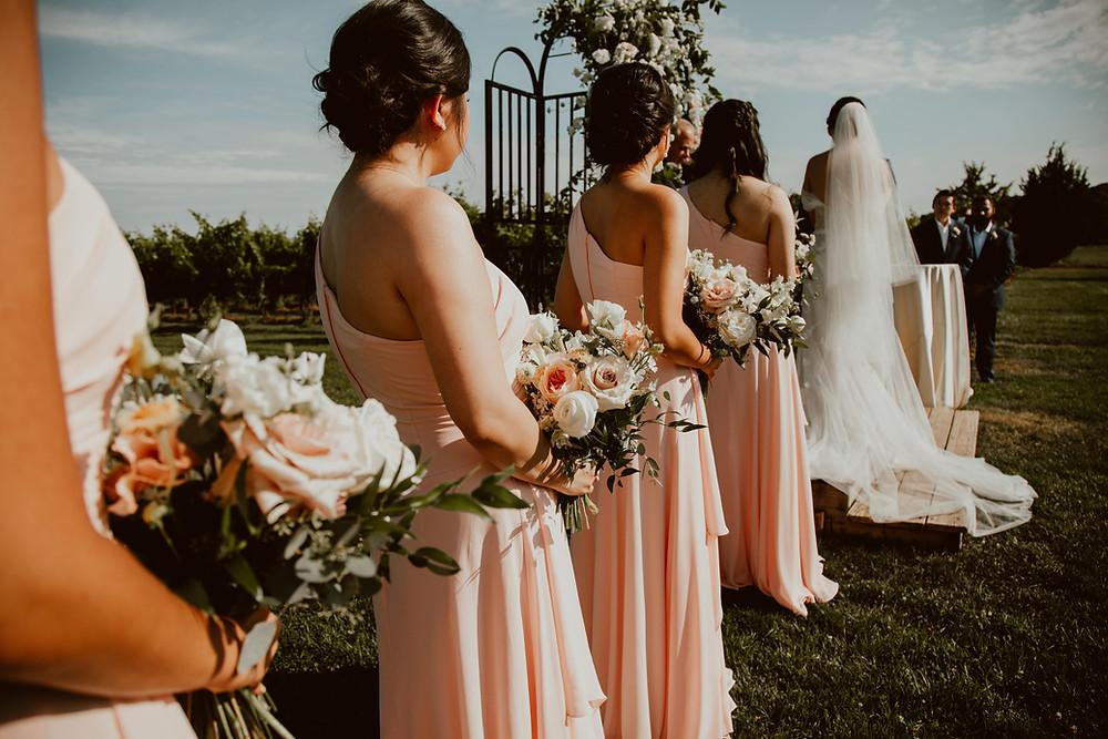 Summer wedding at Saltwater Farm Vineyard with blush pink bridesmaids