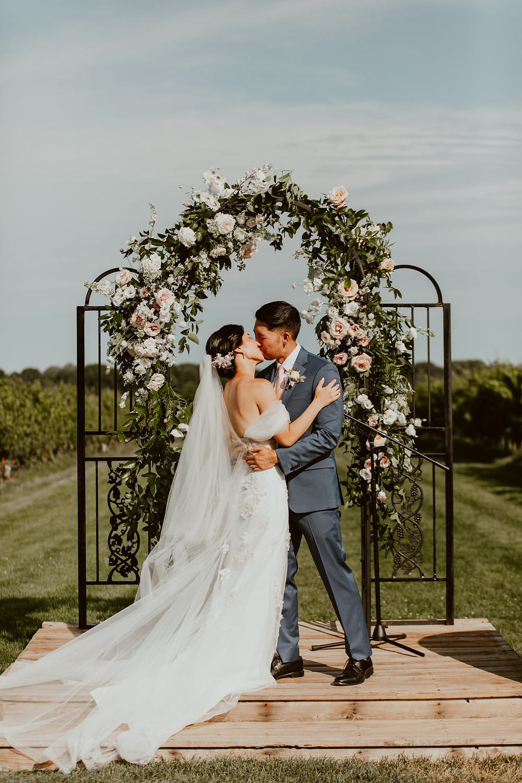 Summer wedding floral arch at Saltwater Farm Vineyard