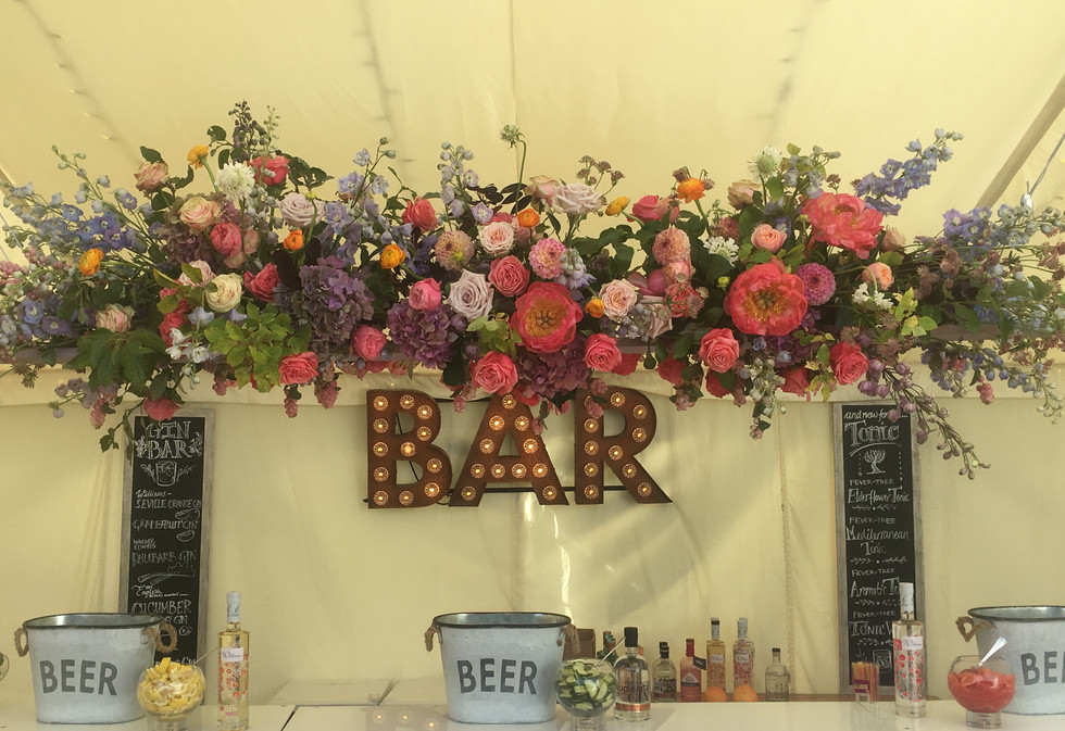 Bar Sign and suspended flowers