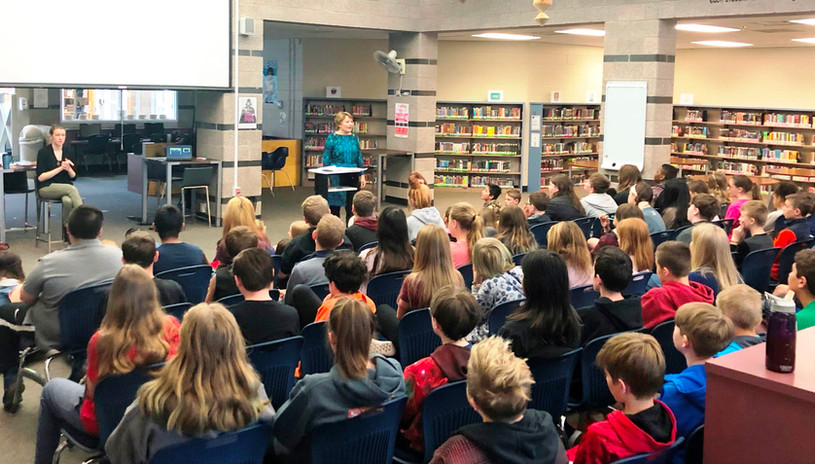 Susan speaking to a middle school