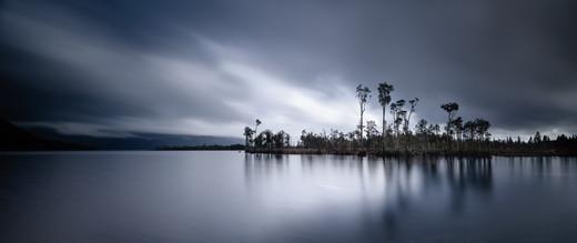 Lake Brunner Skies  The iconic trees that hug the shorelines of lake Brunner, West coast New Zealand  LS027