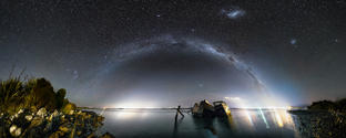 The Bluff Shipwrecks  The milky way running from Invercargill to Bluff, with Tiwai Point smelter illuminating the background