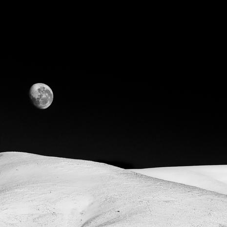 Lunar Landscape  The moon setting behind snow-capped hills near Lake Heron, Ashburton district, New Zealand  BW012