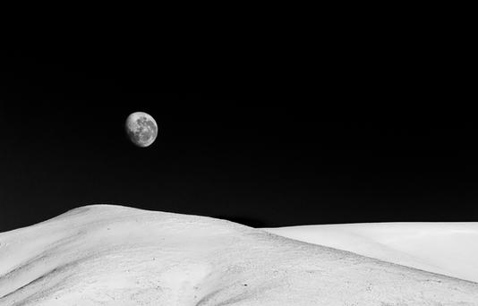Lunar Landscape  The moon setting behind snow-capped hills near Lake Heron, Ashburton district, New Zealand  BW012