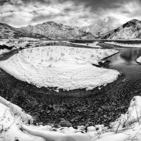 Oxbow  I was lucky enough to find myself near Hanmer just after a big dump of fresh snow. Luckily the reaods were clear before the snow and it had left just a soft layer over everything. This section of river in the Acheron valley was particularly fascinating to m, especially as the local natives had clearly been wandering around in search of food ealier that day...  This is a panorama of 3 images, shot on a canon 16-35 f/4, then stitched together in PT Gui  BW011