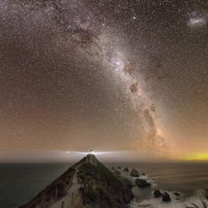 A Light in the Darkness  Champion Image 2017 Laurie Thomas New Zealand Landscape Salon  Nugget point lighthouse in the Catlins shines out into a gorgeous clear night, with a hint of the Aurora Coriolis to the South