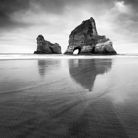 Archway Islands  The now infamous Wharariki beach at the very top of the South Island, new Zealand.  The sea stacks are a beautiful landmark, but the incredibly smooth, flat beach and beautiful tones in the sand create captivating patterns beneath your feet, as the waves roll in  This image is available as an A2 signed, limited edition (20) fine art print - Get in touch for more details  Print 1/20: $448.50 NZD