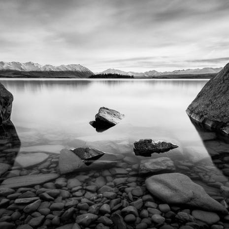 Tekapo Tranquility  A calm winter's morning looking up Lake Tekapo towards the Southern Alps.  This image is available as an A2 signed, limited edition (20) fine art print - Get in touch for more details  Print 1/20: $448.50 NZD  Due to the complexities of the New Zealand Department of Conservation concession laws, this image is currently unavailable for purchase. Feel free to get in touch with your local MP to help remedy this!