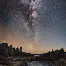 Colours in the Night  The Milky Way rises above a reservoir on the west coast, New Zealand.