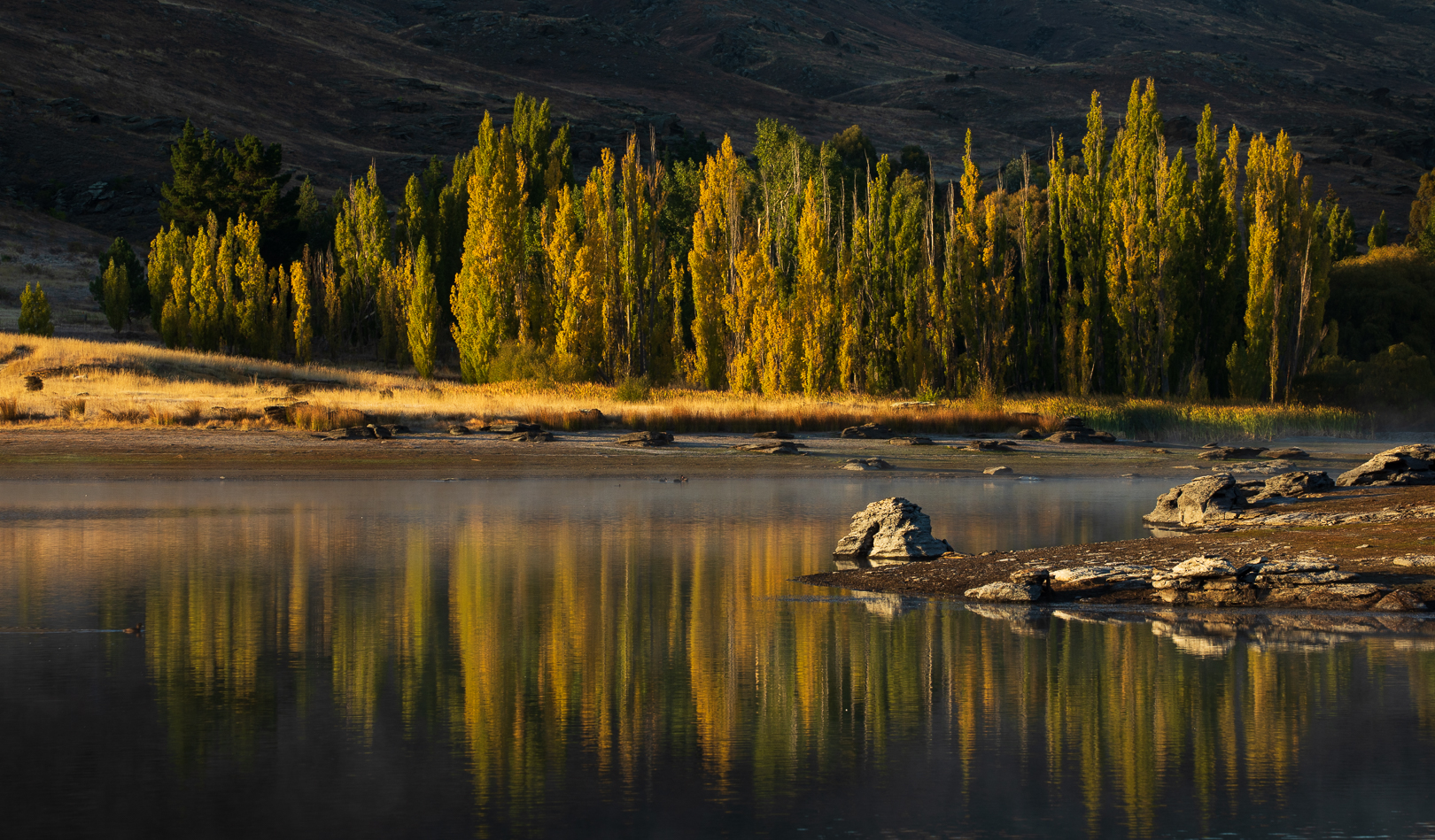 Early autumn colours reflected in a Central Otago lake