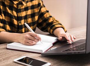 closeup-student-takes-exam-online-via-in