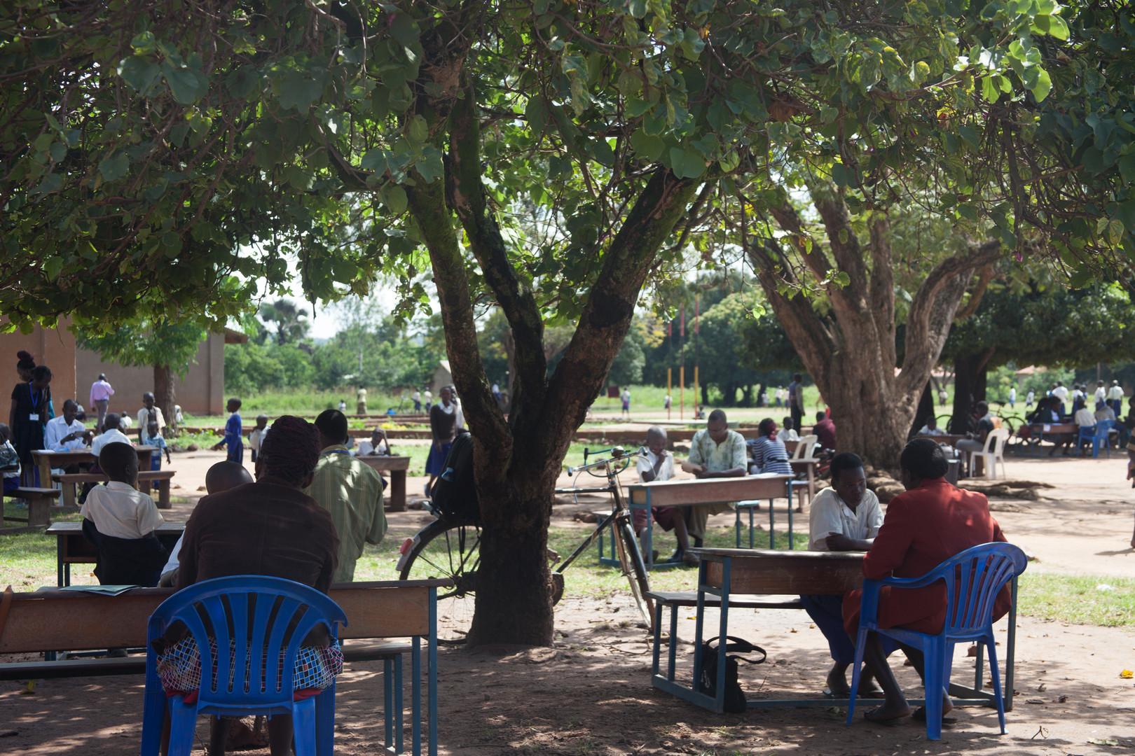 Enumerators testing pupils who have Mango Tree Teacher Mentor Program classrooms.