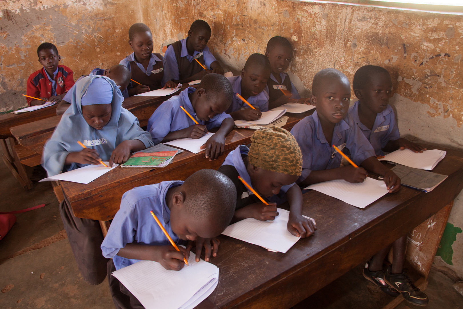 Enumerators also give out math and writing exams, to further assess the pupils' progress.