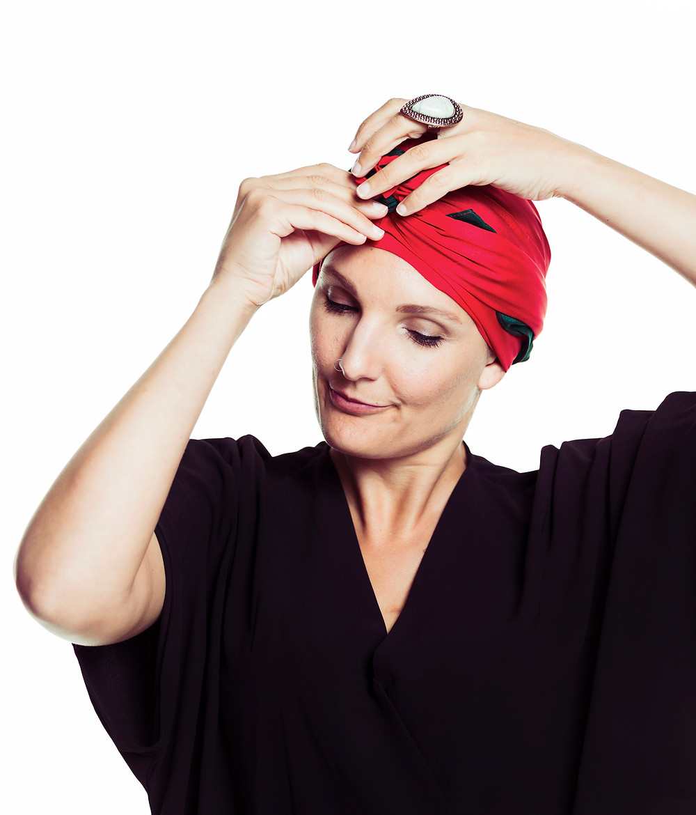Emily Somers Bravery Co tying the MOGA red and green silk scarf.