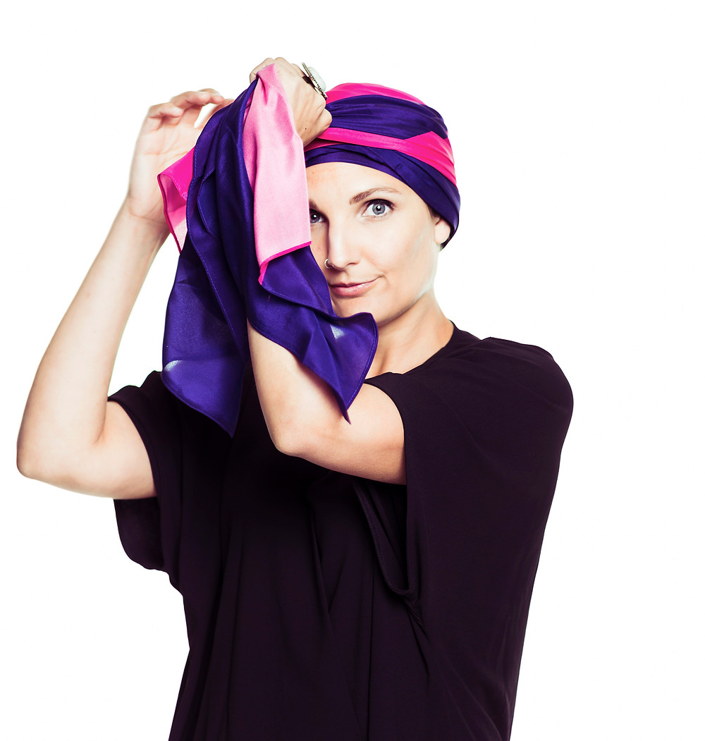Emily Somers tying a turban with the MOGA pink purple scarf