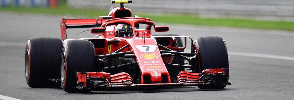 Kimi Raikkonen e Sebastian Vettel fazem dobradinha da Ferrari no grid de largada do GP de Monza na Itália