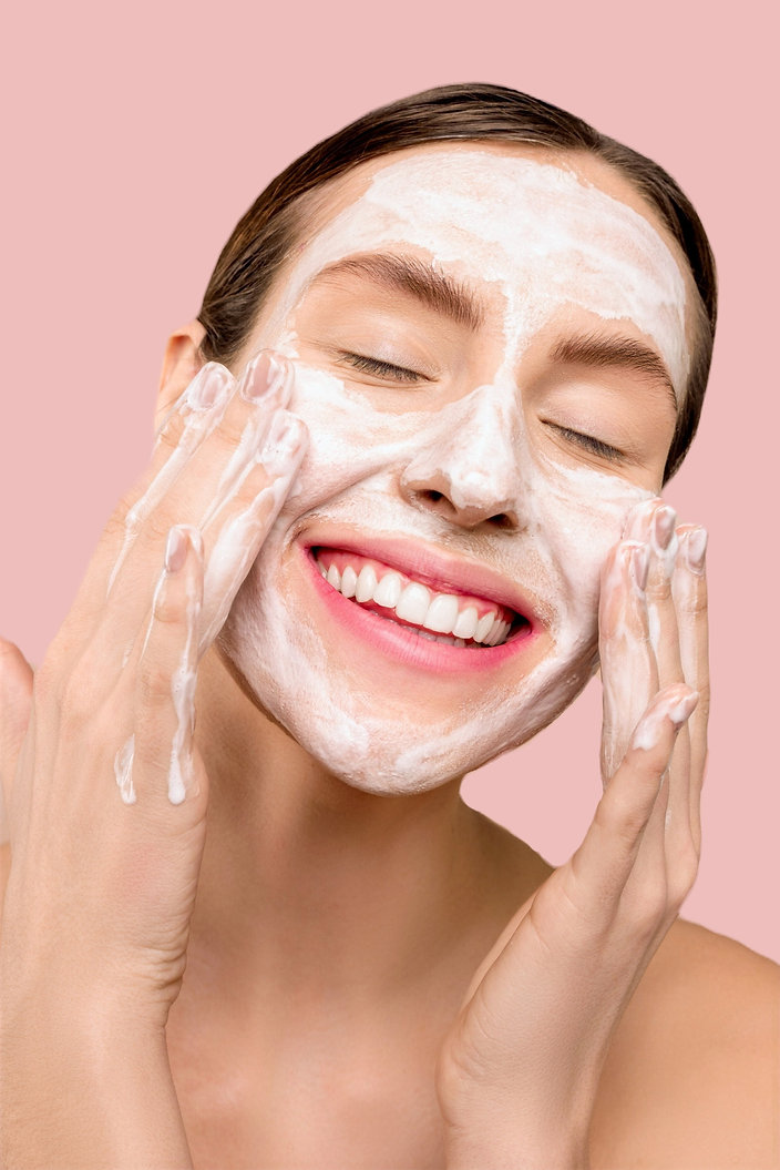 Woman washing face with cleanser