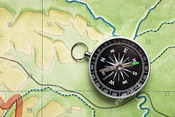 stock-photo-compass-on-a-map-78779524_ed