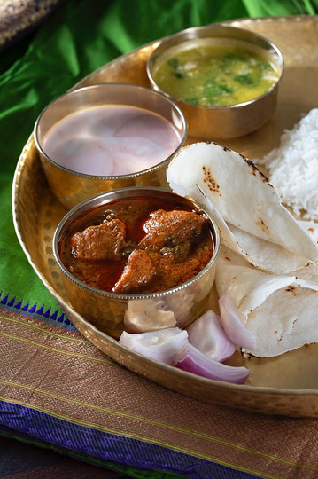 Mutton Curry with Rice Bhakri