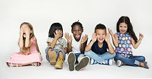Diverse group of children doing peek a boo hand gesture.jpg