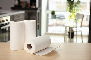 Rolls of paper towels on table indoors.j