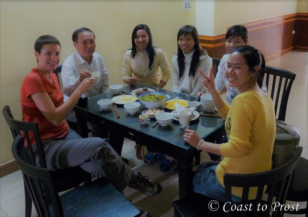 eating dinner with friends around table Hue Vietnam