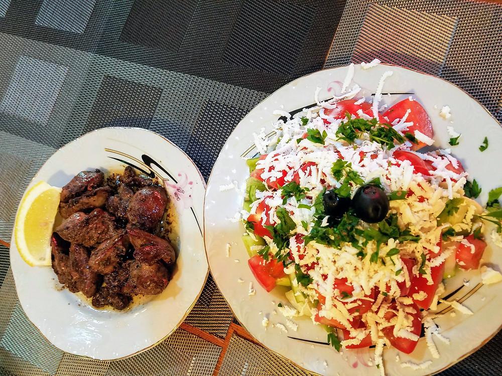 Bulgarian specialties of chicken livers and shopska salad