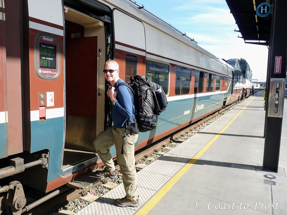 Greg man with backpack boards an Amtrak train