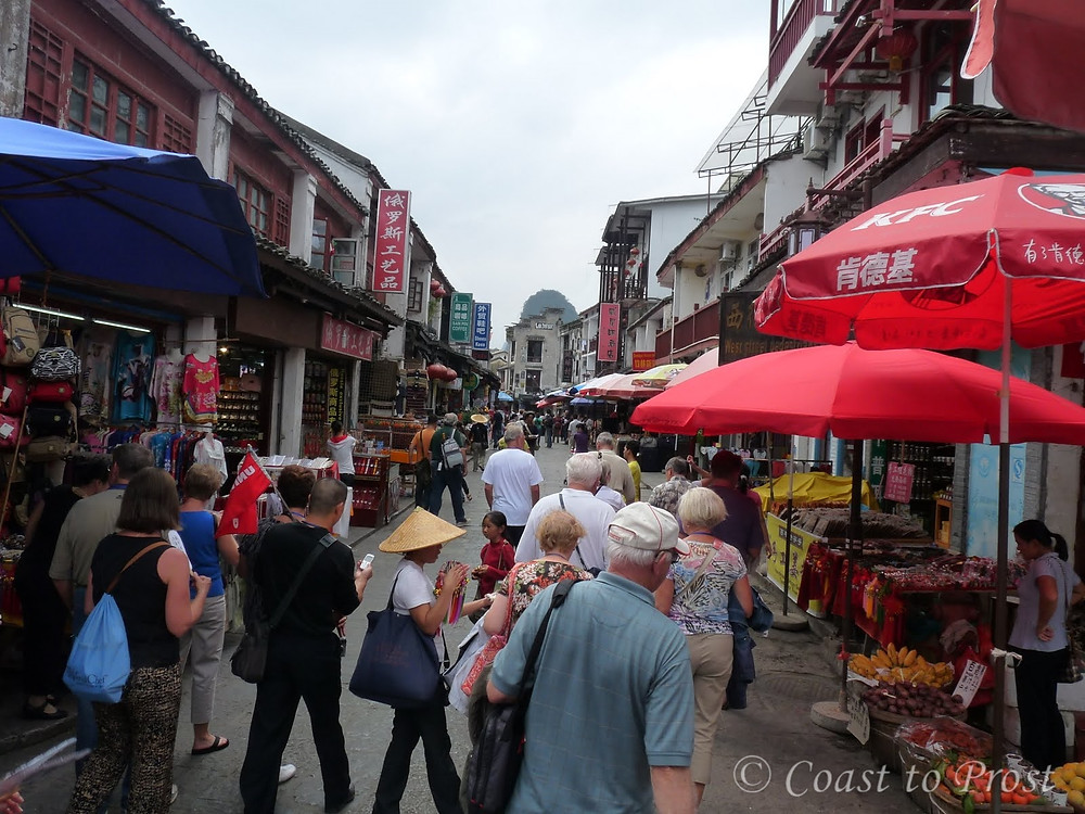 Yangshuo China West Street filled with tourists souvenir shops KFC