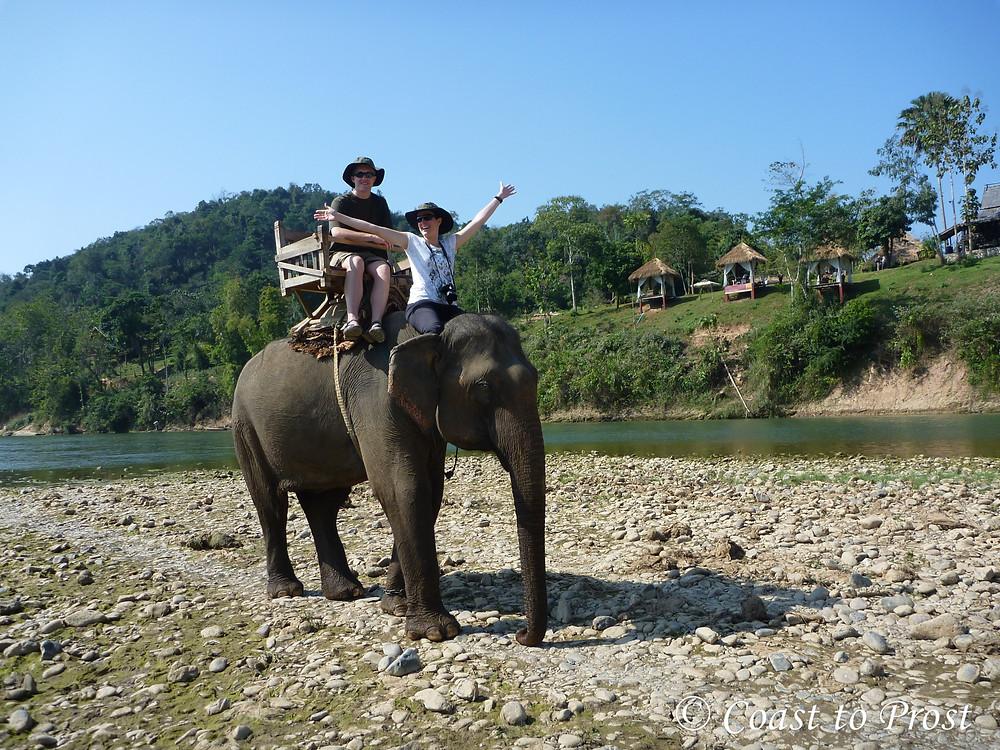 riding an elephant in Luang Prabang Laos river bed