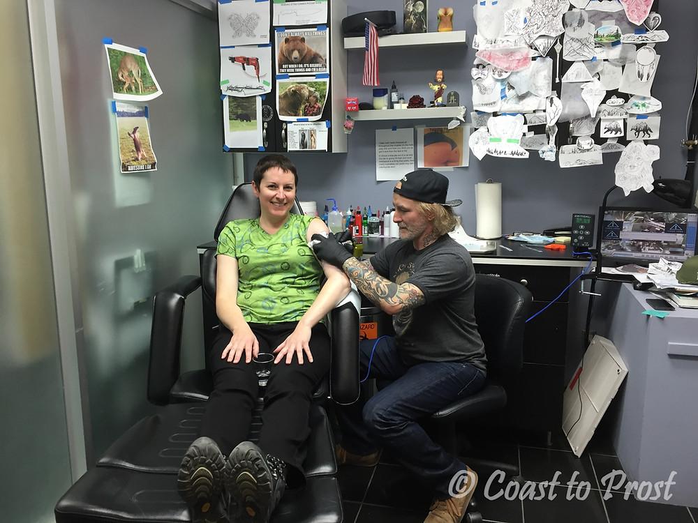 Alethea getting a tattoo in Banff