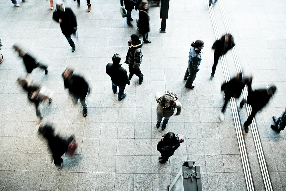 People moving through a concourse