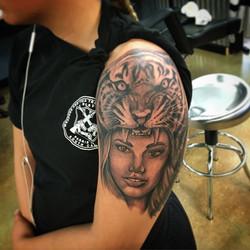 woman with tiger headdress tattoo