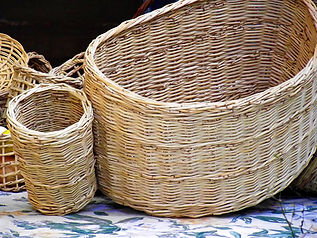 Half-round willow basket with woven side pockets