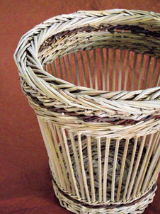 A Spaced Woven Basket with a Decorative Trac Border