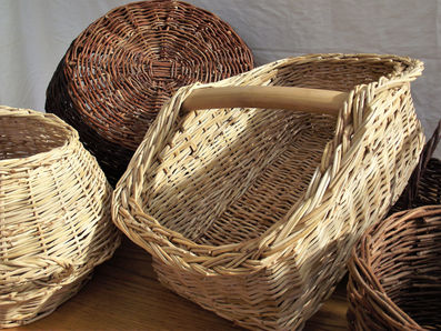A Large Square Basket with a Wooden Handle