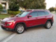 New red Jeep Cherokee with window tint
